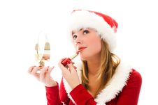 Free Girl Dressed As Santa Painting Her Lips Stock Photo - 6817810