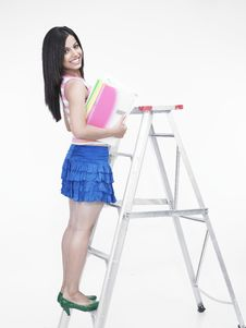 Free Asian Woman Climbing A Ladder Royalty Free Stock Photo - 6818495