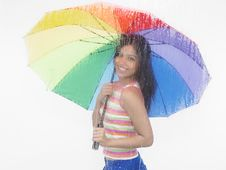 Girl With A Rainbow Umbrella Stock Photos