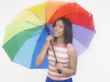 Free Woman With A Colourful Umbrella Royalty Free Stock Photos - 6818588