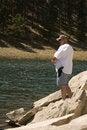 Free Man Fishing In Rocks Royalty Free Stock Photos - 6824488