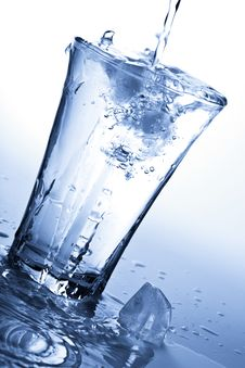 Water Splashing Into Glass With Ice Cubes Royalty Free Stock Image