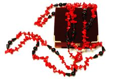 Coral Red And Black Beads (necklace) And Chest. Stock Images