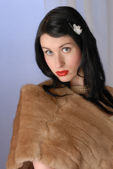 Fifties Pinup Girl In Fur Wrap Royalty Free Stock Image