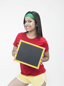 Free Asian Girl Holding A Slate Royalty Free Stock Photography - 6821187