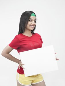 Free Asian Girl Holding A Placard Stock Photography - 6821202
