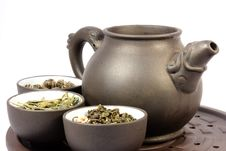 Teapot And Three Bowls. Stock Image
