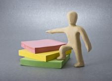 Plasticine Man And Notes Royalty Free Stock Photo