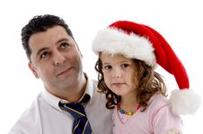 Free Girl Wearing Christmas Hat Posing With Her Father Stock Image - 6824921