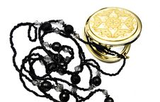Pocket Mirror And Beads Royalty Free Stock Photography