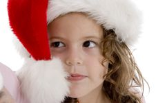 Free Little Girl Wearing Christmas Hat Stock Images - 6824974
