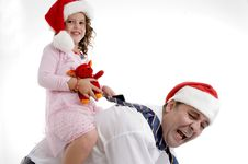 Smiling Little Girl Sitting On Her Father S Back Royalty Free Stock Photos