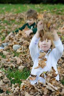 Playing In The Autumn Leaves Royalty Free Stock Photo