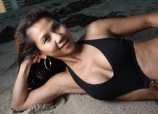 Free Woman Laying On Sand Stock Photos - 6827343