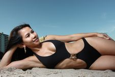 Woman Laying On Sand Stock Images