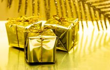 Free Gift Boxes On Golden Stock Image - 6828761