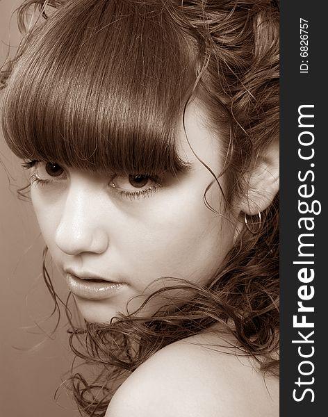 Nice girl with penetrating glance (Sepia)