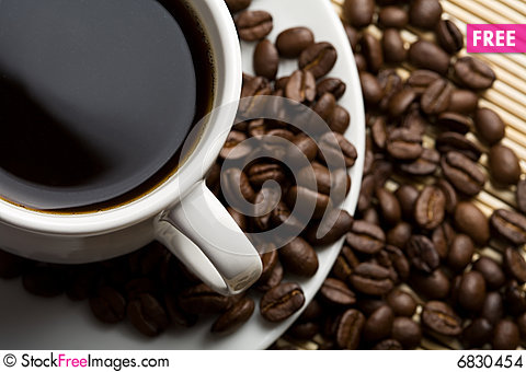 Free Cup Of Coffee And Coffee Beans Stock Images - 6830454