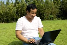 Free Man Using A Laptop Outdoors Stock Image - 6833041
