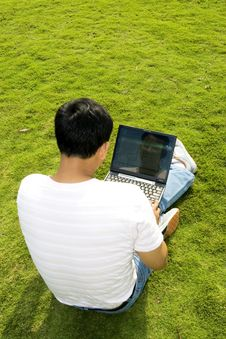 Free Man Using A Laptop Outdoors Royalty Free Stock Image - 6835156