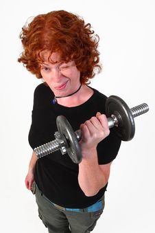 Free RedHead Woman Weight Lifting Royalty Free Stock Photo - 6839215