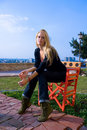 Free Beautiful Blondy Sitting On Red Chair Stock Images - 6841824