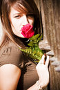 Free Woman Smiling Rose Over Fence Stock Image - 6845571
