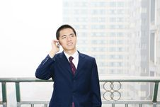 Free Young Business Man Holding Mobile Phone Stock Images - 6840664