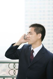Free Young Business Man Holding Mobile Phone Royalty Free Stock Image - 6840666