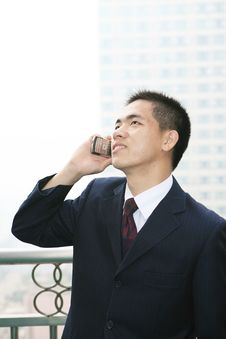 Free Young Business Man Holding Mobile Phone Royalty Free Stock Photos - 6840668
