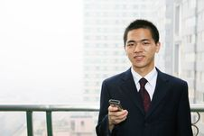 Free Young Business Man Holding Mobile Phone Stock Images - 6840684