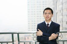 Free Young Business Man Holding Mobile Phone Royalty Free Stock Photography - 6840687