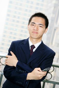 Free Young Business Man Holding Mobile Phone Stock Photo - 6840690