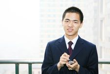Free Young Business Man Holding Mobile Phone Royalty Free Stock Photo - 6840745