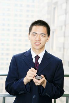 Free Young Business Man Holding Mobile Phone Royalty Free Stock Photography - 6840747
