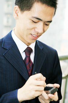 Free Young Business Man Holding Mobile Phone Stock Photo - 6840750