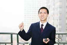 Free Young Business Man Holding Mobile Phone Stock Photo - 6840780