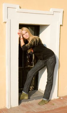 Free Beautiful Blondy Standing Against Windows Stock Images - 6841804