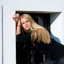 Free Beautiful Blondy Standing Against Windows Stock Image - 6841811