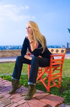 Free Beautiful Blondy Sitting On Red Chair  In Sun Stock Photography - 6841812