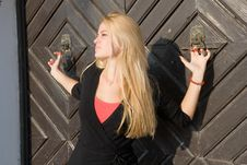 Free Beautiful Blondy Standing Against Door Royalty Free Stock Photography - 6841827