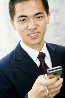 Free Young Business Man Holding Mobile Phone Stock Photography - 6841952