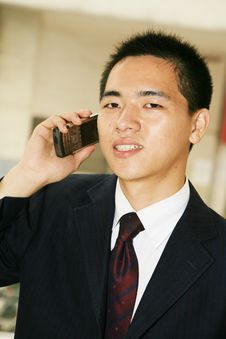 Free Young Business Man Holding Mobile Phone Royalty Free Stock Images - 6842859