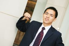 Free Young Business Man Holding Mobile Phone Royalty Free Stock Photo - 6843855