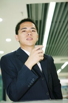 Free Young Business Man Holding Mobile Phone Royalty Free Stock Photo - 6843925