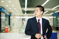 Free Young Business Man Holding Mobile Phone Royalty Free Stock Image - 6844056