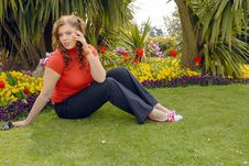 Girl In Red In Beautiful Gardens Stock Image