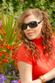 Girl In Sunglasses In Beautiful Gardens Royalty Free Stock Photos