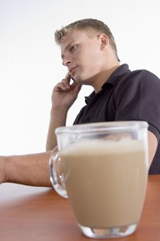 Man Busy On Cell Phone With Tea Cup Stock Image