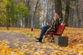 Free Young Woman Sitting On A Bench Royalty Free Stock Photo - 6853265